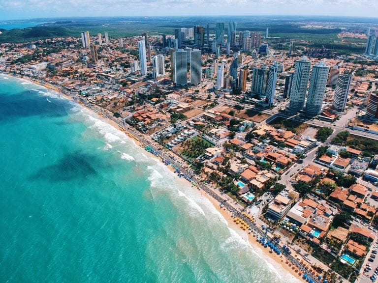 aerial photography of city building near the seashore during daytime